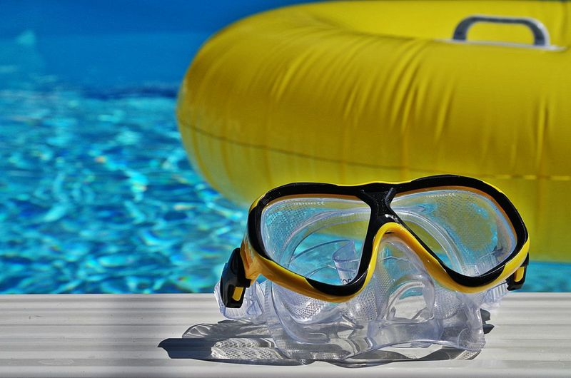 Swimming goggles at poolside