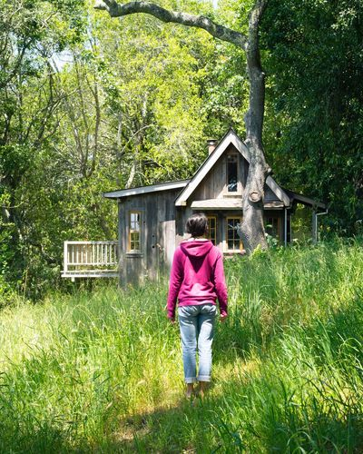 Rear View Full Length Tree One Person Architecture Built Structure Walking Real People Outdoors Building Exterior Day Grass Nature Lifestyles Leisure Activity Standing Growth Women Beauty In Nature Adult Cottage Rural Poetry