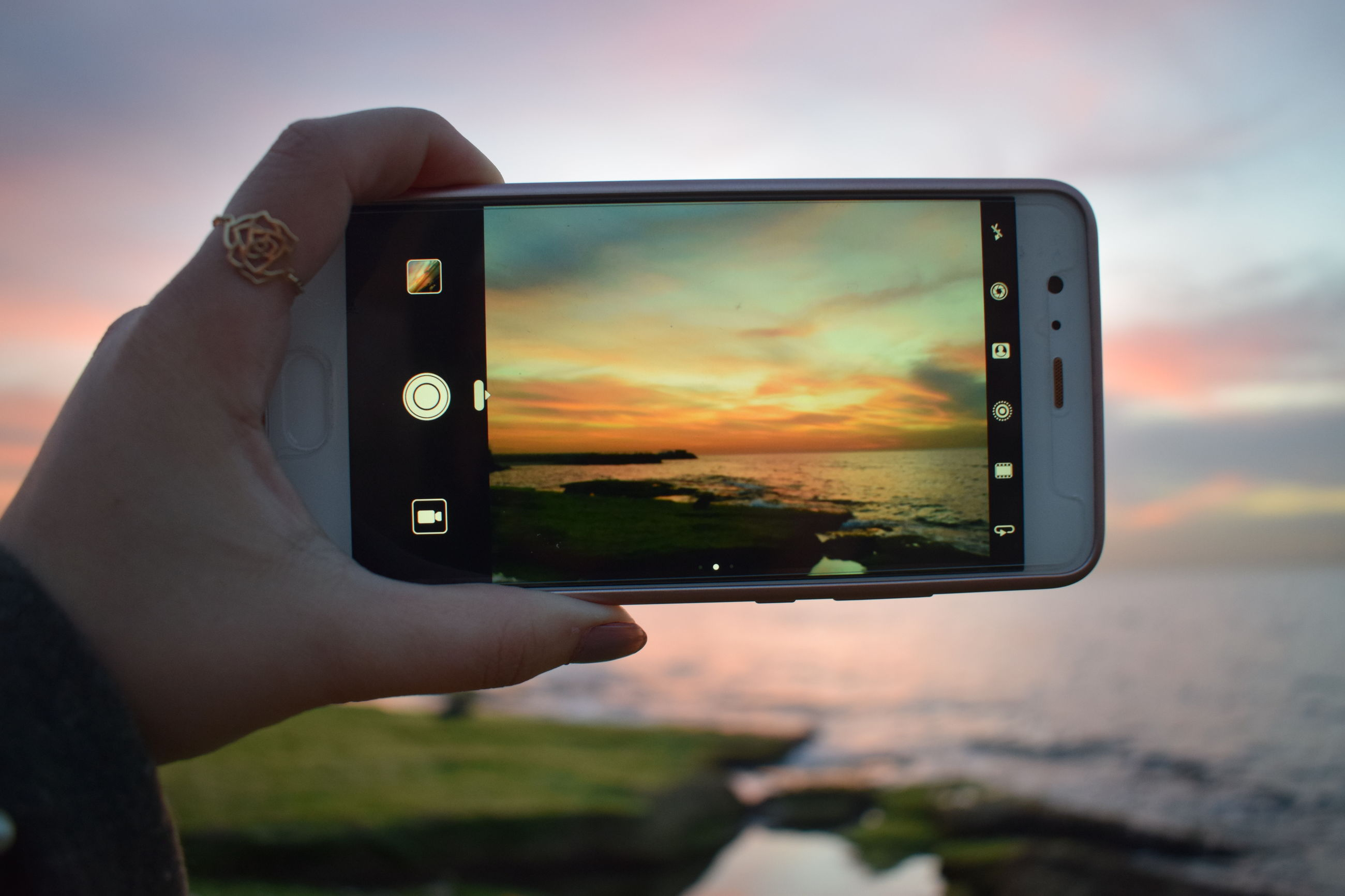 technology, photography themes, wireless technology, human hand, holding, sunset, hand, one person, human body part, communication, sky, real people, smart phone, photographing, connection, portable information device, screen, mobile phone, focus on foreground, activity, outdoors, finger