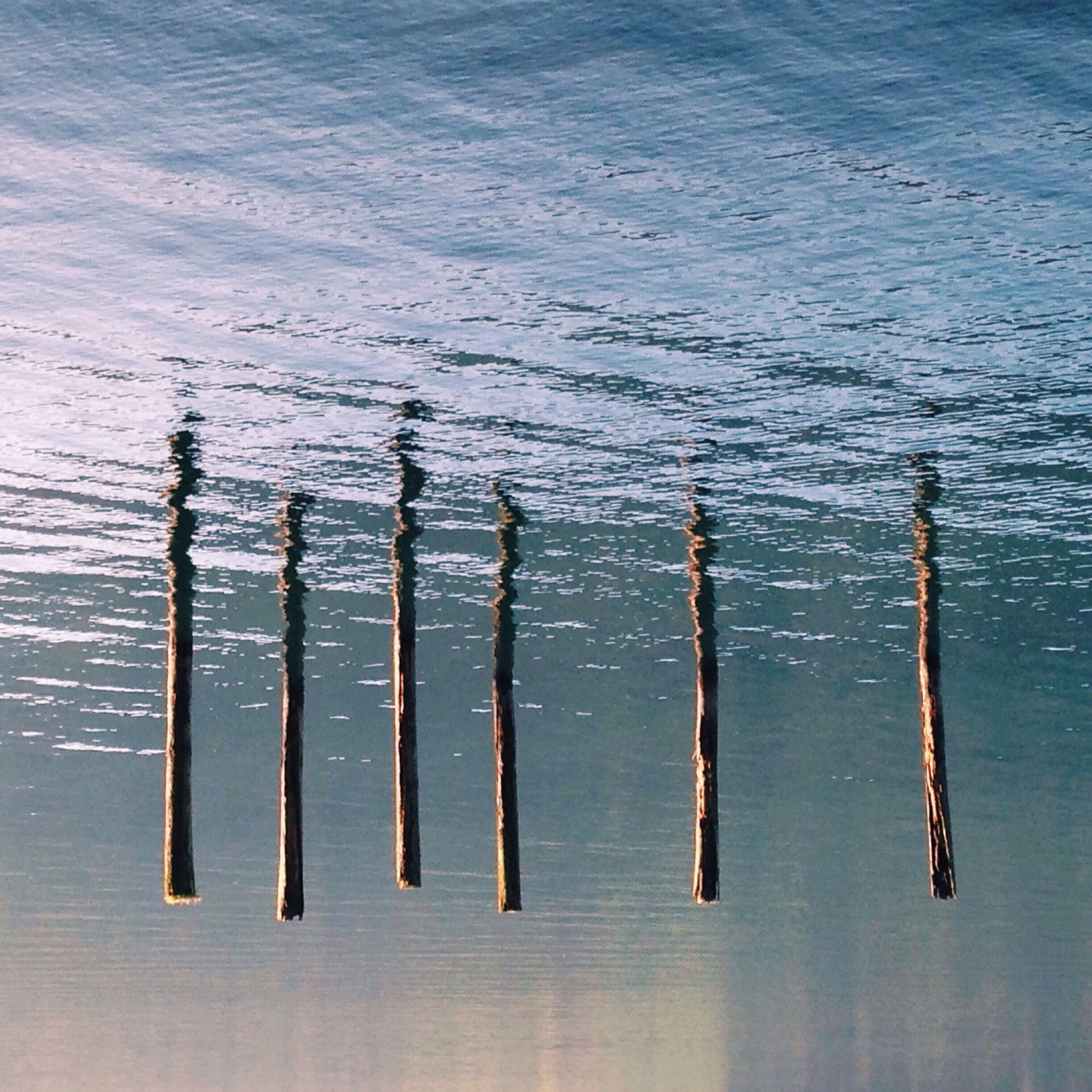 wood - material, water, close-up, high angle view, still life, wooden, in a row, no people, textured, nature, backgrounds, side by side, pattern, full frame, wooden post, day, outdoors, metal, large group of objects, tranquility