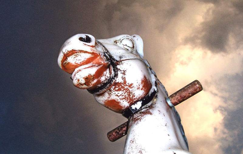 one of my first photos i ever took. Bouncy Horse Childs Toy Close-up Dramatic Eye Handle Horse Mouth No People Nose Piercing Old One Of My First Photographs Outdoors Outside Peeling Paint Plastic Bag Sky Spring Horse Stormy Toy Worn