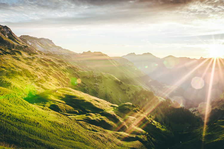 golden mountains II Beauty In Nature Cloud Cloud - Sky Field Green Color Growth Idyllic Landscape Lens Flare Mountain Mountain Range Nature No People Non-urban Scene Outdoors Remote Rural Scene Scenics Sky Sun Sunbeam Sunlight Sunset Tranquil Scene Tranquility