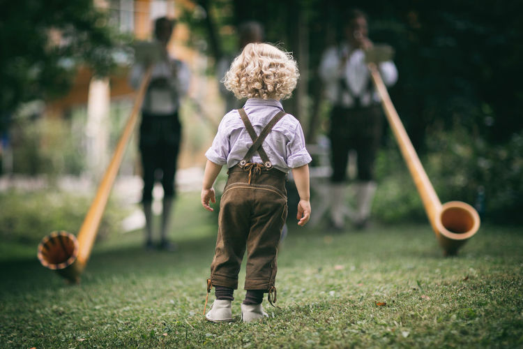 keeping tradition alive. Back-to-the-came Bavaria Bayern Costume Depth Of Field Dof Green Leather Pants Lederhosen Muted Colors Observer Perspective Standing Three Traditional
