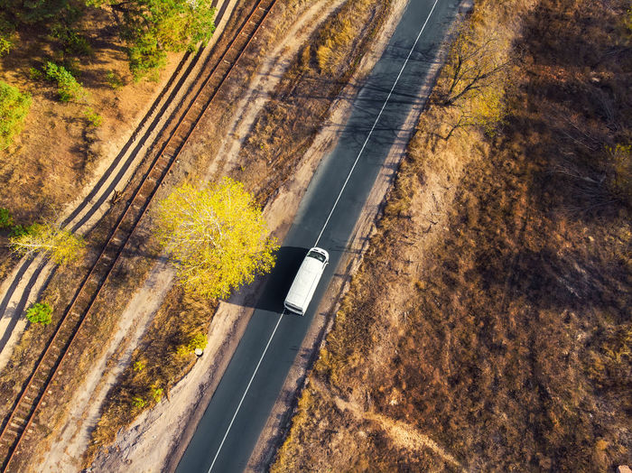 High angle view of car moving on road
