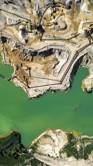 High Angle View Of Coal Mine By River On Sunny Day