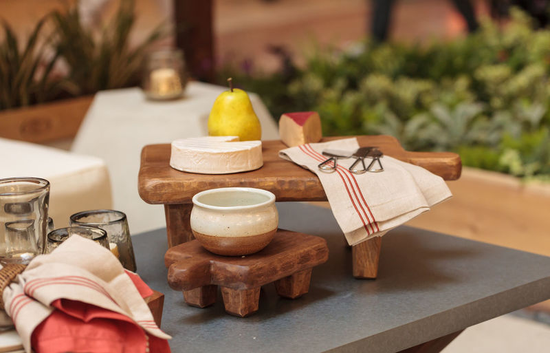 Cheese platter and fruit on an outside patio on a summer evening Brie Cheese! Close-up Cutting Board Decor Food Garden Home Indoors  Knife Napkin Patio Pear Picnic Platter Snack