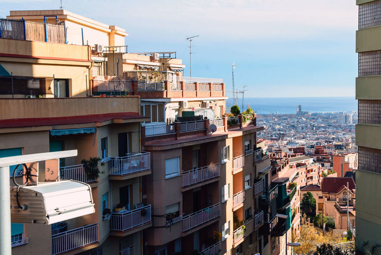 ordinary buildings at sunset Barcelona spain catalonia Building Exterior Architecture Built Structure Building Residential District City Sky Nature No People Window Day Outdoors Cityscape Water Apartment High Angle View Cloud - Sky Balcony