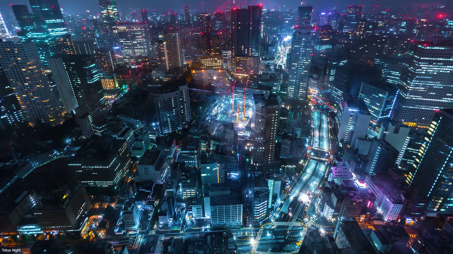 High angle view of illuminated modern buildings in city at night