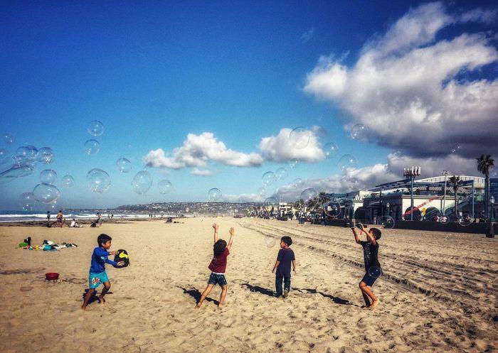 Bubbles EyeEm Team EyeEm Gallery Bubbles Children Kids Sky Beach Land Sand Sea Water Cloud - Sky Holiday Sport Leisure Activity Outdoors Group Of People Trip