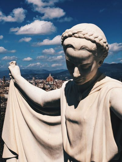 Angels on the City EyeEm Selects Florence Italy Firenze Italia Cityscape Sculpture Statue Art And Craft Human Representation Representation Cloud - Sky Sky Creativity Architecture No People Day Nature Front View Outdoors Built Structure History Fine Art Statue
