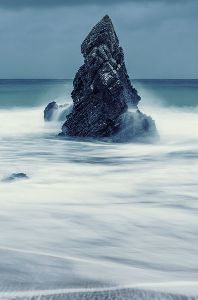 #Dark #atmosphere #rocks #seascape #water Beauty In Nature Cloud - Sky Day Horizon Over Water Iceberg Motion Nature No People Outdoors Power In Nature Rock - Object Scenics Sea Sky Tranquil Scene Tranquility Water Waterfront Wave