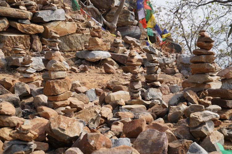 Religious Abundance Balance Buddhism Day High Angle View Land Large Group Of Objects Low Section Nature Outdoors Real People Rock Rock - Object Solid Stack Standing Stone Stone - Object Stone History Stone Wall Tree