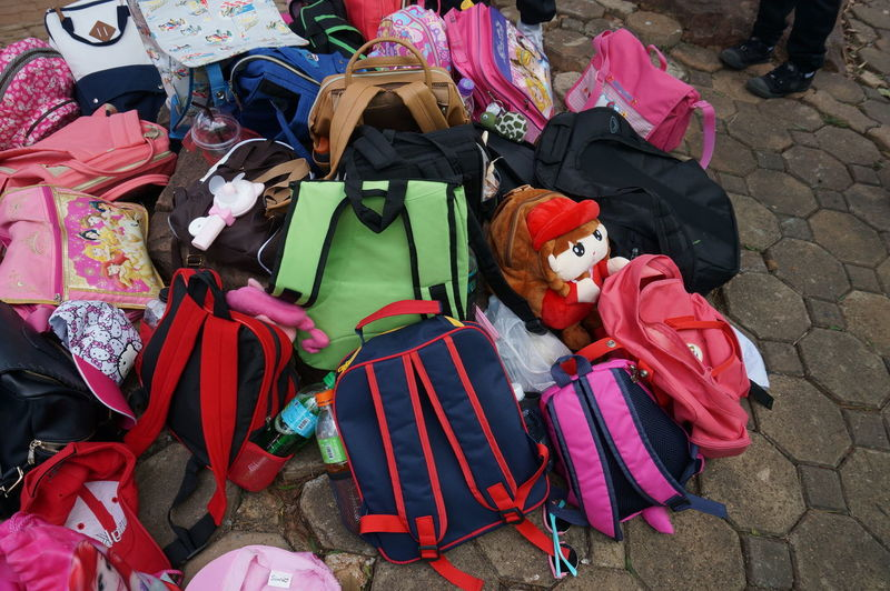 High Angle View Of Bags On Footpath