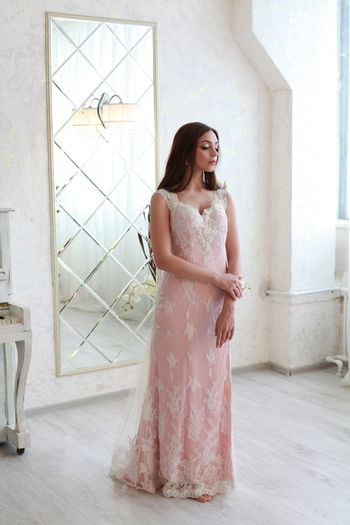 Pink Color Pink Dress Water Wedding Dress Bride White Background One Person Dress Smiling Women Fashion Lifestyles Happiness Real People Full Length Young Adult Indoors  Standing Clothing Young Women Leisure Activity Beauty Beautiful Woman Emotion Hairstyle