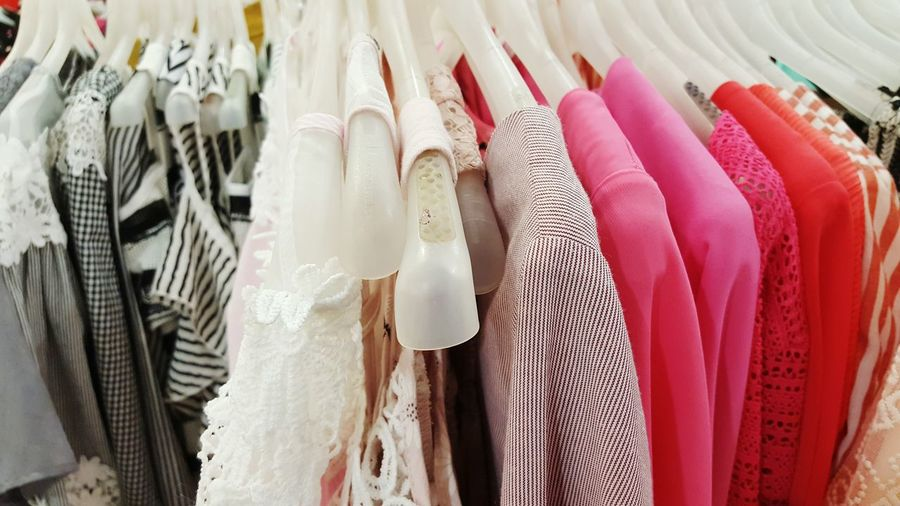 Close-Up Of Clothes Hanging On Coathangers