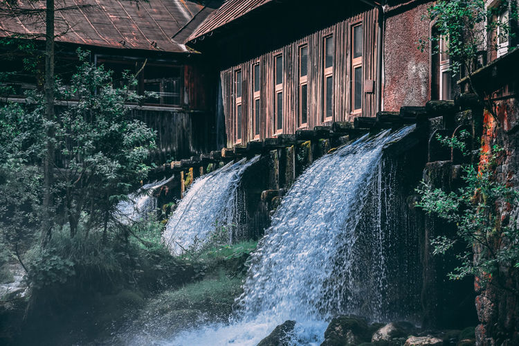 Watermills under houses in forest