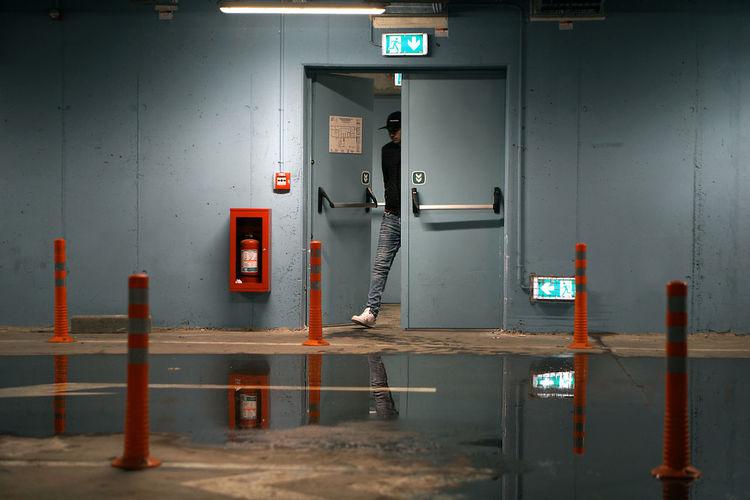 Man walking into parking garage