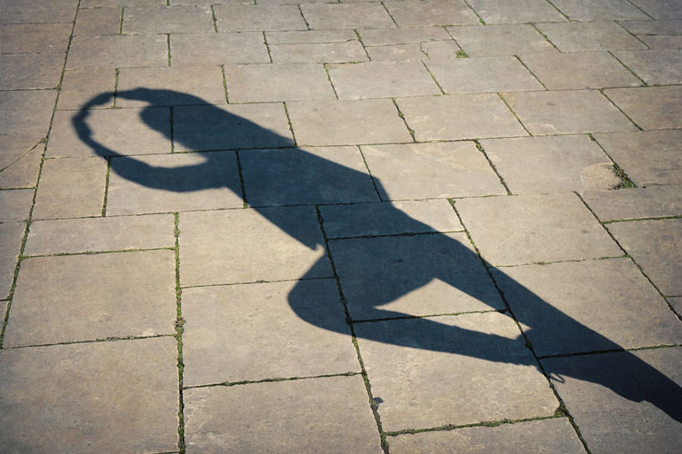 High angle view of ballet dancer shadow on street