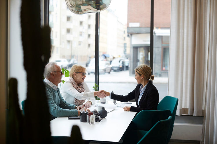 People sitting on table in cafe