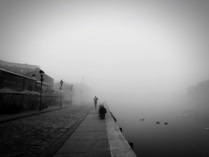 Running out of the heavy fog Fog Real People One Person Outdoors Lifestyles The Way Forward Cold Temperature Winter Foggy Day Nature Street Streetphotography Old Town Eye4photography  EyeEmNewHere Vagabond EyeEm Best Edits EyeEmBestPics EyeEm Best Shots Full Length Foggy Weather Foggy Morning Blurry Background Fashion Stories EyeEmNewHere
