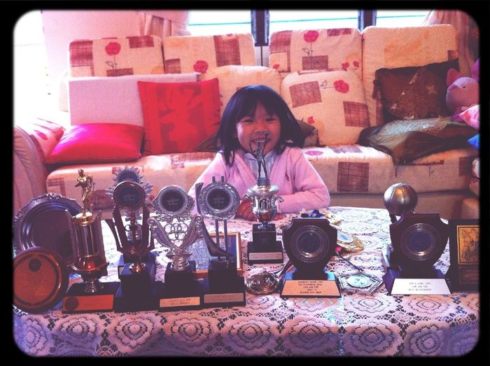 Pea with a bunch of hubs' trophies from his old sch days!;)