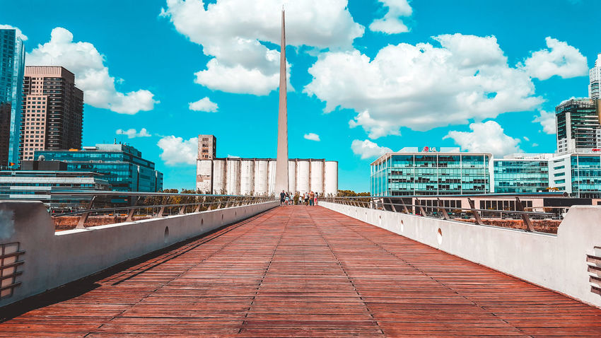 Puente de la Mujer Architecture Building Exterior Built Structure City Cloud - Sky Day Modern One Point Perspective Outdoors Perspective Photography Puente De La Mujer Sky The Way Forward Travel Destinations Adventures In The City