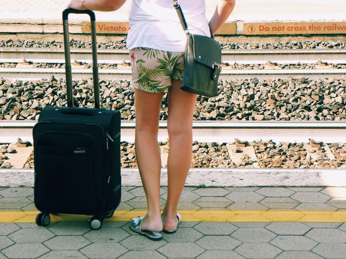 Low Section Suitcase Luggage Travel Human Leg Adult Women Lifestyles Travelling Going On Holiday Taking The Train Railway Railway Track Train Station Train Station Platform Waiting For A Train Woman With Suitcase One Person Standing Summer Loose Clothing