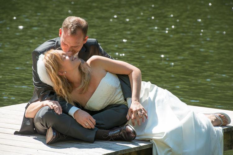 Couple sitting on a lake