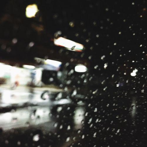 น้ำฝน Wet Illuminated Night Rain Drop No People Architecture City Water Window Glass - Material Outdoors Snowing Transparent Built Structure Street Rainy Season Nature Transportation RainDrop