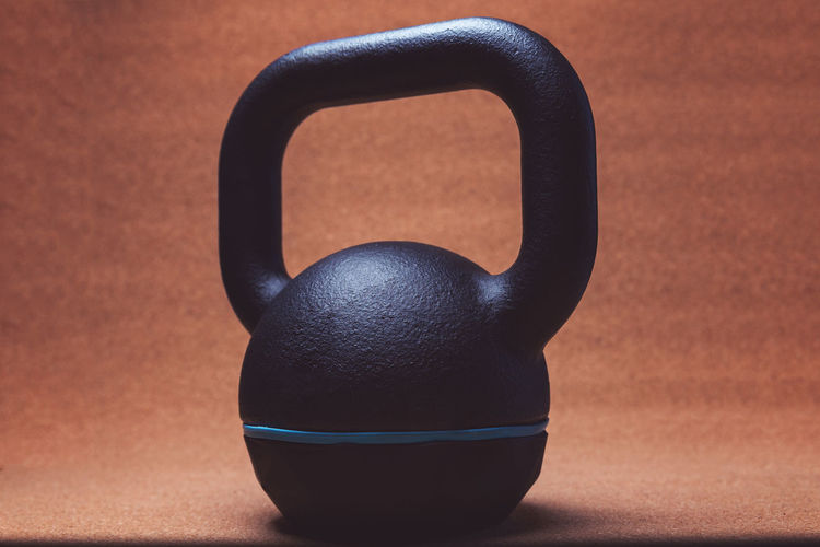 Close up view of a kettlebell - studio shot Heavy Light Black Color Body Building Close-up Equipment Fit Fitness Focus On Foreground Food Gym Healthy Eating Healthy Lifestyle Indoors  Kettlebell  Muscular Build No People Shadow Shape Sport Still Life Studio Shot Table Training Weight