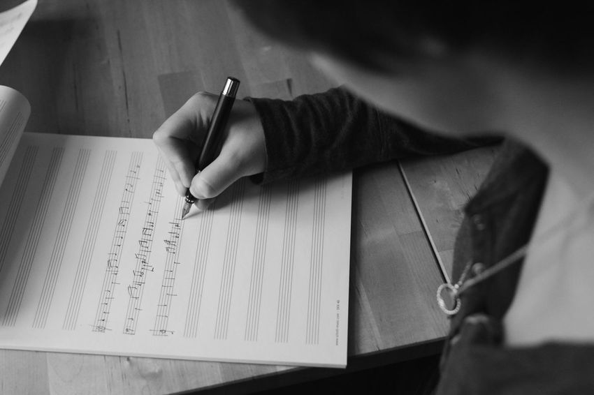 Composition Music Writing Music Close-up Compose Composing Day Holding Human Body Part Human Hand Indoors  Learning Music Notes Music Sheet Musical Instrument One Person Paper Pen People Preparation  Real People Sheet Music Table Writing