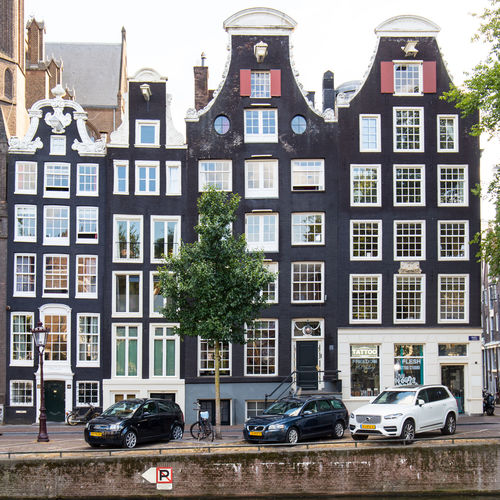 Amsterdam Netherlands Apartment Architecture Building Building Exterior Built Structure Canal Houses Car City Day Dutch Architecture Dutch Houses Holland Land Vehicle Mode Of Transportation Motor Vehicle Nature No People Plant Residential District Road Street Tourism Transportation Tree Window