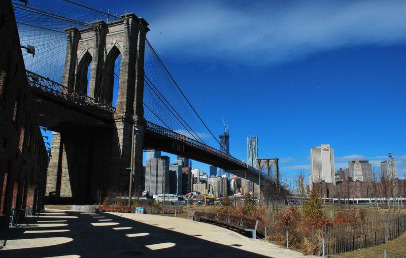 Brooklyn Bridge By City Against Sky
