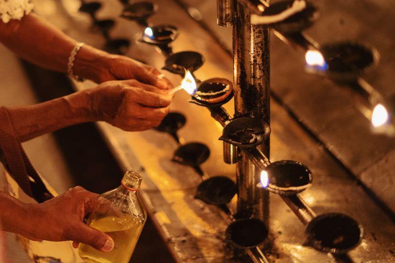灯油。 Storytelling Sri Lanka No Face Streetphoto_color Buddhist Temple Candlelight Prayers Shadows & Lights Peace And Quiet Snapseed Yellow Color Templephotography SONY A7ii Sonyphotography Human Hand Close-up Lit Flame Fire