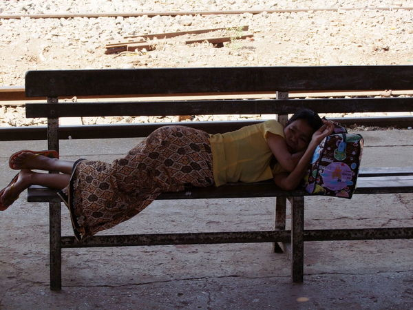 Sleeping in Train Station Bench City City Life City Lifestyle Composition Full Frame Full Length Indoor Photography Myanmar One Person One Woman Only Poor Woman Relaxation Sleeping Social Issues Sunlight And Shade Tired Tourism Tourist Destination Traditional Clothing Travel Destination Woman Yangon Yangon Circular Railway Yangon Circular Train