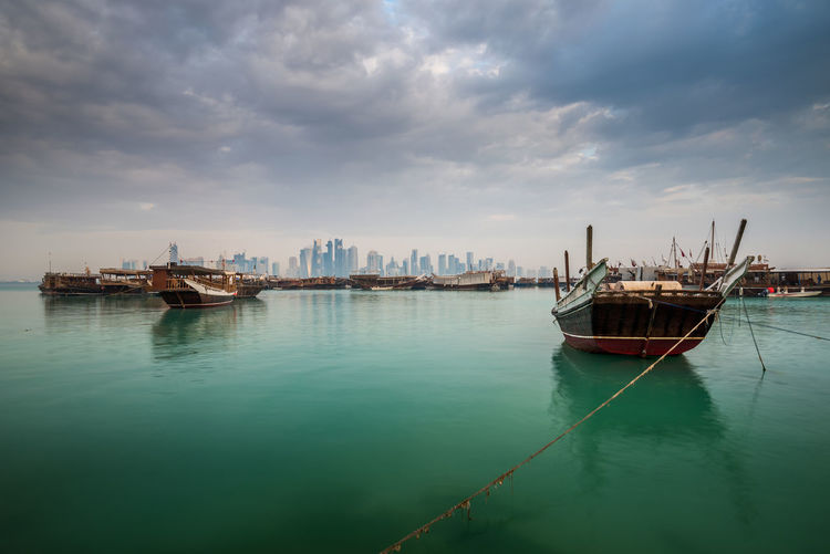 Morning view of Doha Corniche, Qatar, Middle East. Transportation Cloud - Sky Nautical Vessel Water Sky Mode Of Transportation Sea No People Architecture Nature Waterfront City Moored Travel Beauty In Nature Outdoors Day Built Structure Scenics - Nature Anchored Doha Qatar Dhow