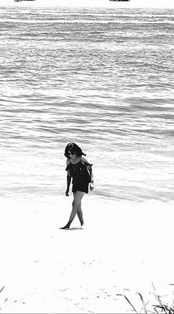 Adventure Beach Beachlife Beauty In Nature Blackandwhite Childhood Day Full Length Leisure Time Nature One Person Outdoors People Quiet Moments Relaxation Exercise Relaxing Standing Summer Summertime Walking Water