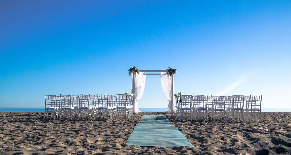Chairs for wedding ceremony on beach