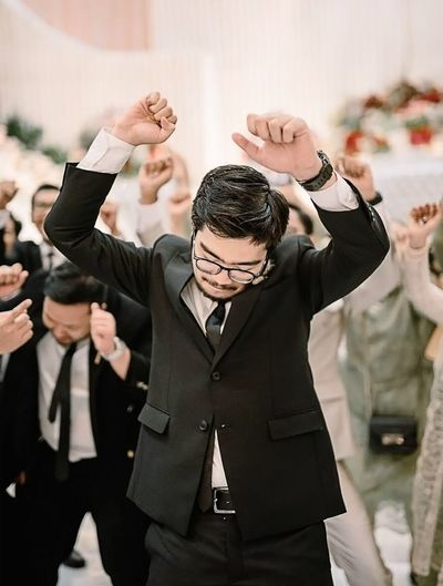 Groomsmen have fun dancing at the wedding party