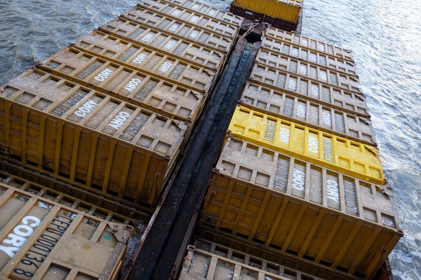 Low Angle View No People Architecture Built Structure Container Container Ship Water Wave Waves Lines Lines And Shapes Industrial Industrial Landscapes Landscapes Day Outdoors Thames River Sea Ocean EyeEm Best Shots Text MISSIONS: The Street Photographer - 2017 EyeEm Awards The Architect - 2017 EyeEm Awards EyeEm LOST IN London Postcode Postcards