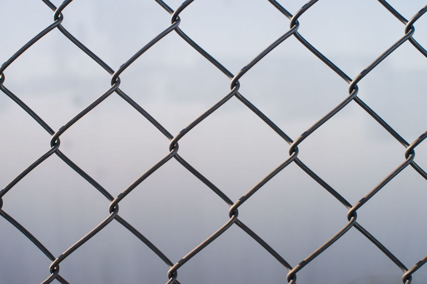 Wire fence in focus on location. Captured with a 50mm 1.4 Day Fence Fencing Focus On Foreground Outdoors Wire Fence
