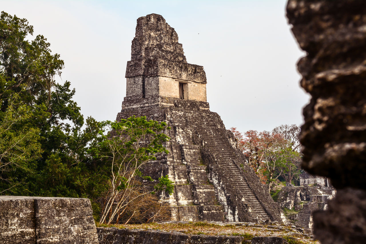 history, old ruin, architecture, ancient, ancient civilization, the past, built structure, day, tourism, travel destinations, outdoors, no people, building exterior, pyramid, sky, tree