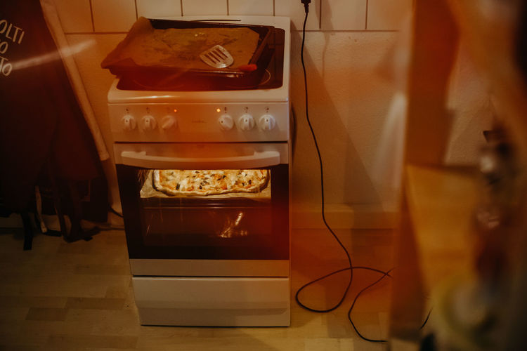homemade pizza in an oven Indoors  Food And Drink Food Nutrition Ingredient Ingredients Italia Italian Food Pizza Pizza Time No People Technology Reflection Domestic Room Kitchen Domestic Kitchen Oven Homemade Homemade Food Homemade Pizza Heating Baking Home