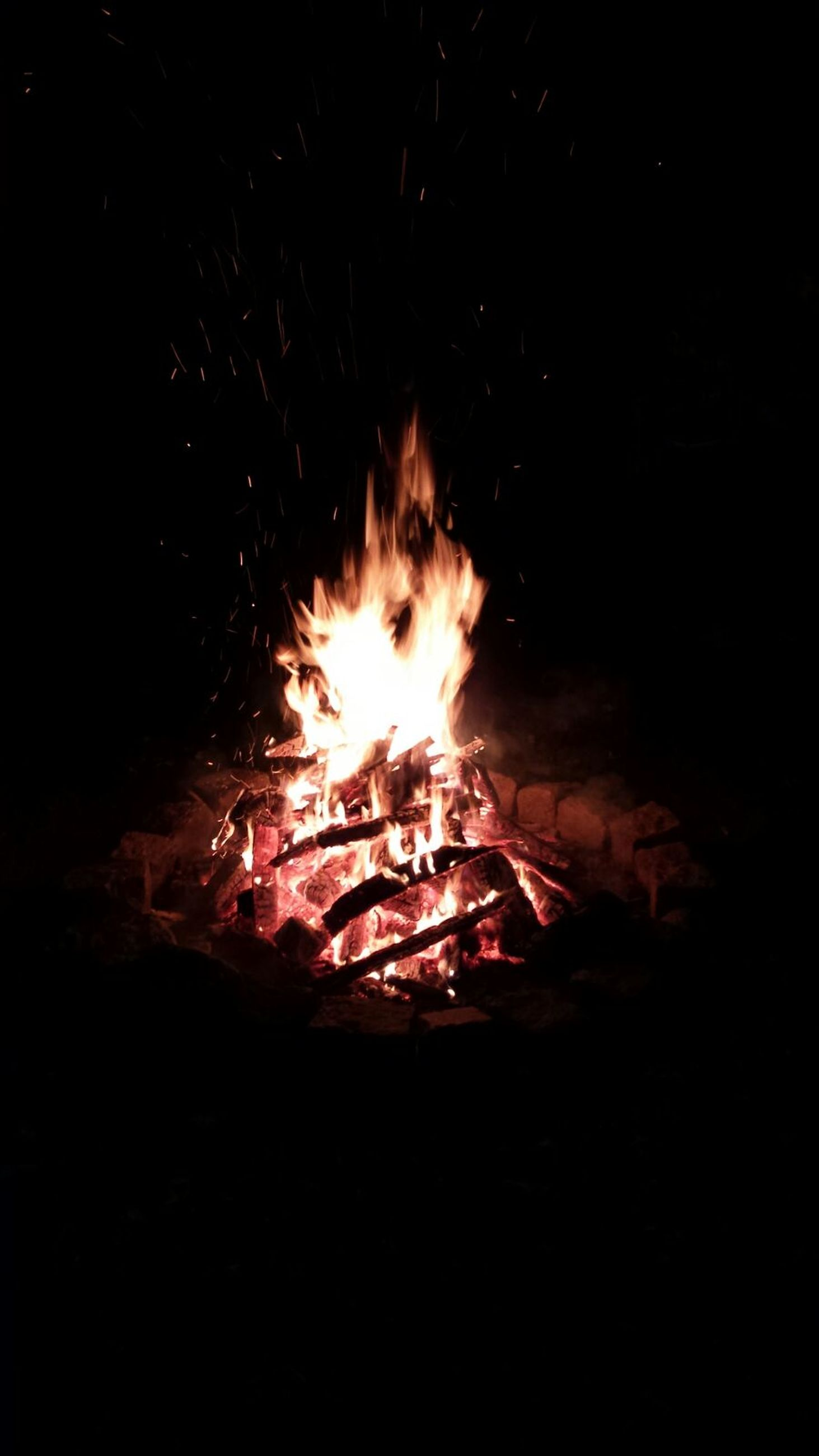 burning, fire - natural phenomenon, flame, night, heat - temperature, glowing, bonfire, firewood, fire, motion, dark, illuminated, long exposure, campfire, heat, light - natural phenomenon, close-up, orange color, no people, copy space