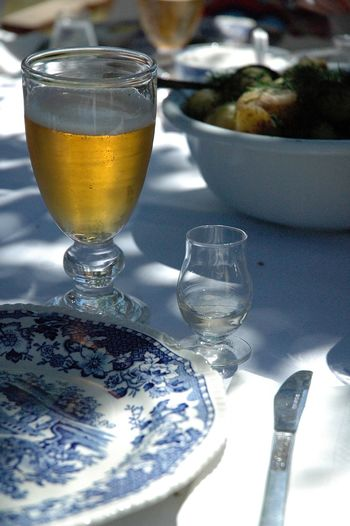 Swedish Food Swedish Dinner Swedish Lunch Dinner Outside Outdoors Dining! Summer Vacation Summertimedrinks Summertime In Sweden Alcohol Beer Beer Glass Close-up Dill Drink Drinking Glass Food And Drink Freshness No People Nubbe Potato Potatoes Refreshment Sill And Potato Snaps Table Vodka Wineglass The Still Life Photographer - 2018 EyeEm Awards