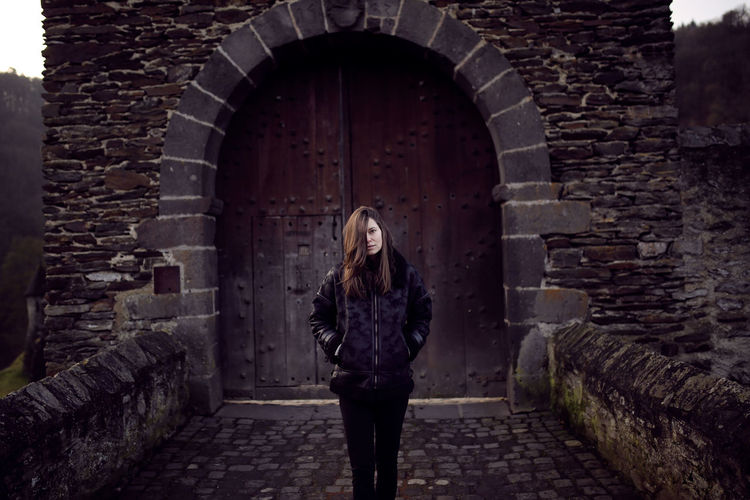 Burg Eltz Architecture One Person Built Structure Arch Standing Hair Wall Young Adult Building Exterior Front View Adult Building Three Quarter Length Brick Wall Hairstyle Long Hair Brick Young Women Beautiful Woman Outdoors Stone Wall Gate Burg Eltz Germany Facing Camera