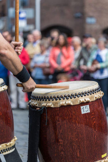 Arts Culture And Entertainment Crowd Day Drum - Percussion Instrument Focus On Foreground Group Of People Incidental People Men Music Musical Equipment Musical Instrument Musician Outdoors People Performance Playing Real People Sitting Spectator