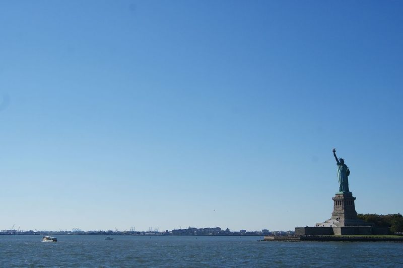 Blue Blue Sky City City Life Famous Place Island Monument New York Panorama Ship Sky Skyline Statue Of Liberty Tourism Tourist Destination Travel USA Water Waterline Wide Angle Winter
