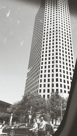People Skyscraper Sky Day City Adult Built Structure Architecture Real People Men Tree Cars HoustonTX Driving Around Blackandwhitephoto Modern