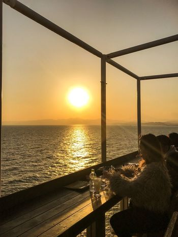 Sunset diner Sunset Sea Sun Nature Horizon Over Water Beauty In Nature Scenics Sky Sunlight Sitting Drink Silhouette Dining Table Dining Room Dining Cafe Sea And Sky Seascape Seaside Sea View Beauty In Nature Japan Photography Japanese Style EyeEmNewHere